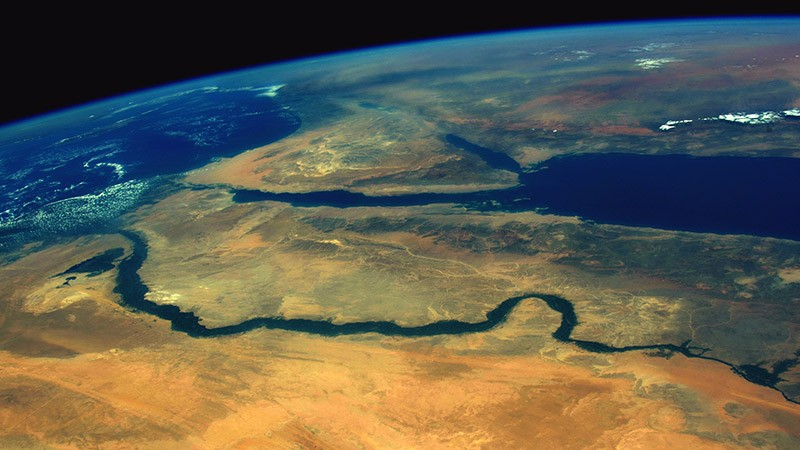 View of the ancient city of Edfu, Egypt on the banks of the Nile River seen from the International Space Station