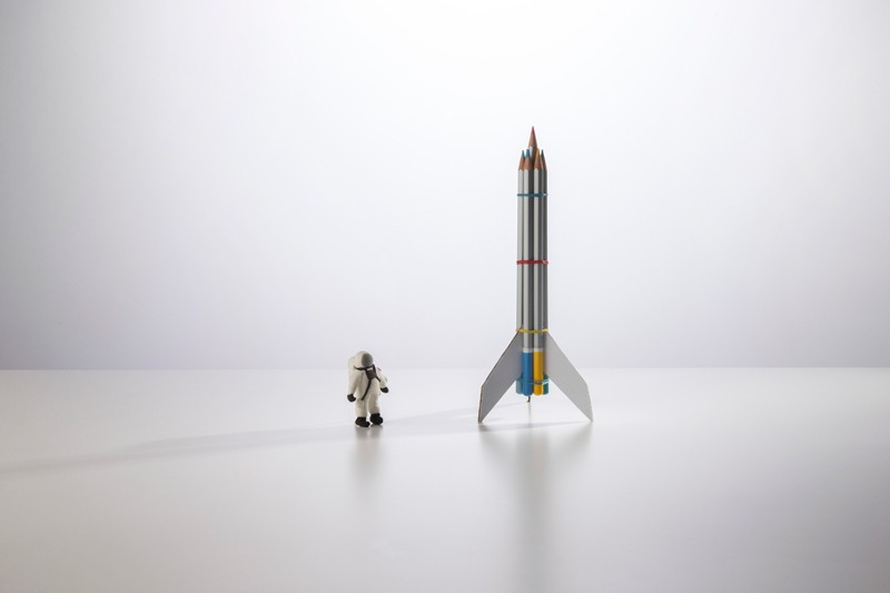 Figurine of astronaut and space rocket