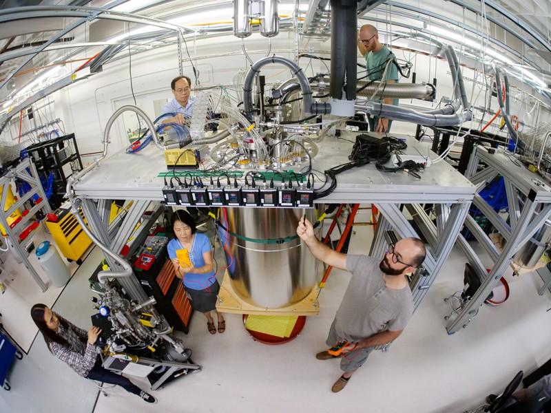 Memner of the Google quantum team work on a cryostat