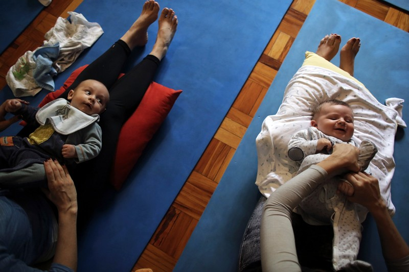 Mothers with babies attend a yoga session