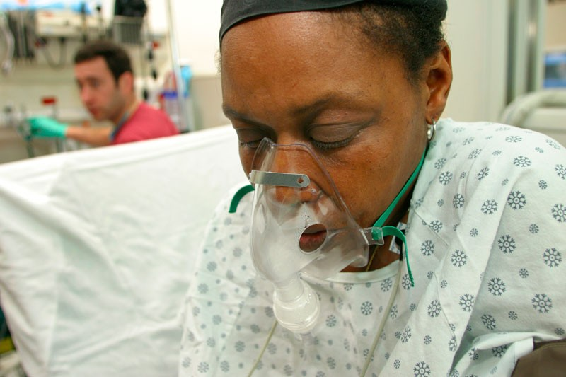 An African American woman in the emergency room of San Francisco General Hospital.