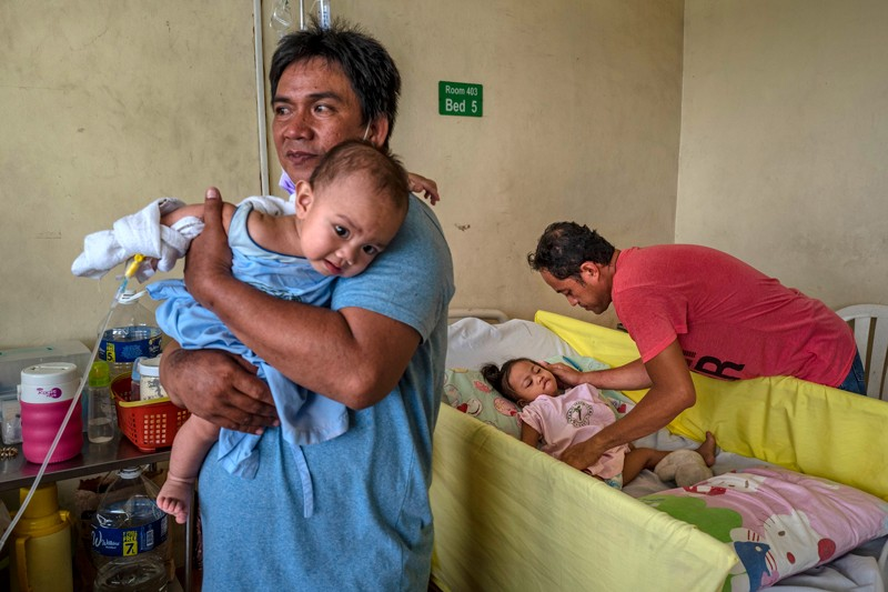 Filipino children suffering from measles are treated at a government-run hospital in Manila, Philippines