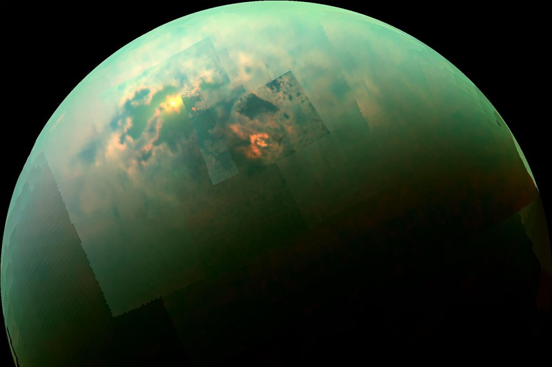 Colour mosaic from NASA's Cassini spacecraft shows the sun glinting off of Titan's north polar seas