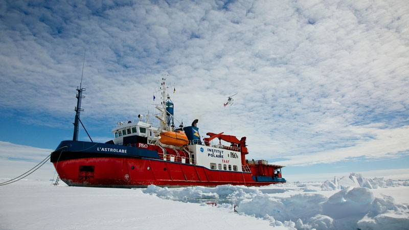 French icebreaker 'L'Astrolabe' moored on the edge of the fast ice off Dumont D'Urville station, Antarctica.